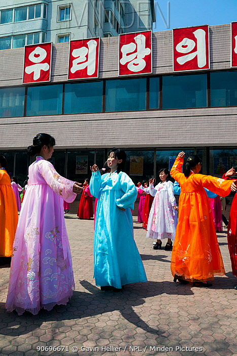 Women in traditional dress dancing during street celebrations on the 100th anniversary of the birth of President Kim IL Sung, Pyongyang, Democratic Peoples' Republic of Korea (DPRK), North Korea, April 15 2012  -  Gavin Hellier/ npl