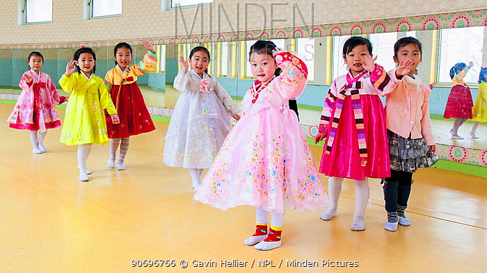 Children in traditional clothes, waving to camera, Mangyongdae Schoolchildren's Palace, dedicated to childrens after school activities, Pyongyang, Democratic Peoples' Republic of Korea (DPRK), North Korea, 2012  -  Gavin Hellier/ npl
