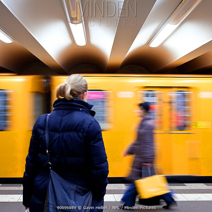 Moving train pulling into the station with people waiting, modern subway station, Berlin, Germany, 2009 No release available  -  Gavin Hellier/ npl