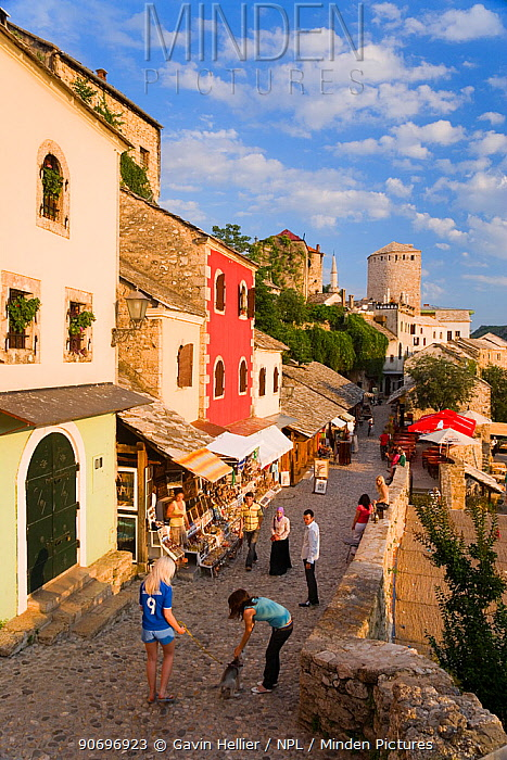 Cobbled street lined with colourful houses known as Kujundziluk, one of the oldest streets in Mostar leading to the Old Bridge, Old Town, Mostar, Herzegovina, Bosnia and Herzegovina, Balkans, 2007 No release available  -  Gavin Hellier/ npl