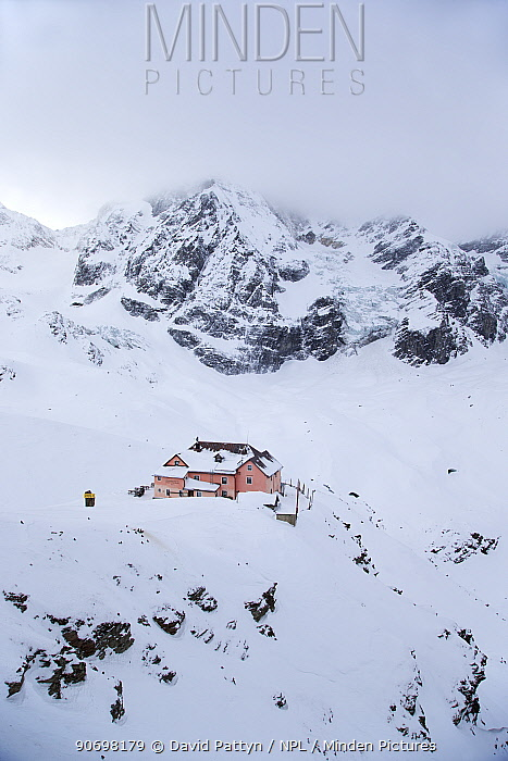 Hotel 'Refugio Citta di Milano' with Glacier of Il Gran Zebru (Konigspitze) on a very cold and cloudy winter day Stevio National Park, Solda, Sulden am Ortler, Sudtirol, Italy January 2013  -  David Pattyn/ npl