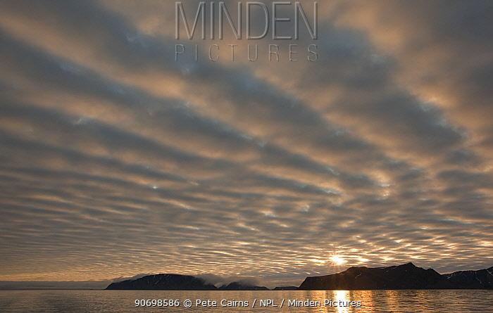 Mountain ridge and dramatic sky, Svalbard, Norway