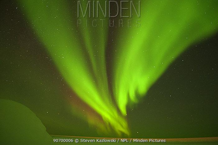 Northern lights / Aurora borealis glowing brightly over the frozen eastern Beaufort Sea, Arctic National Wildlife Refuge, Alaska