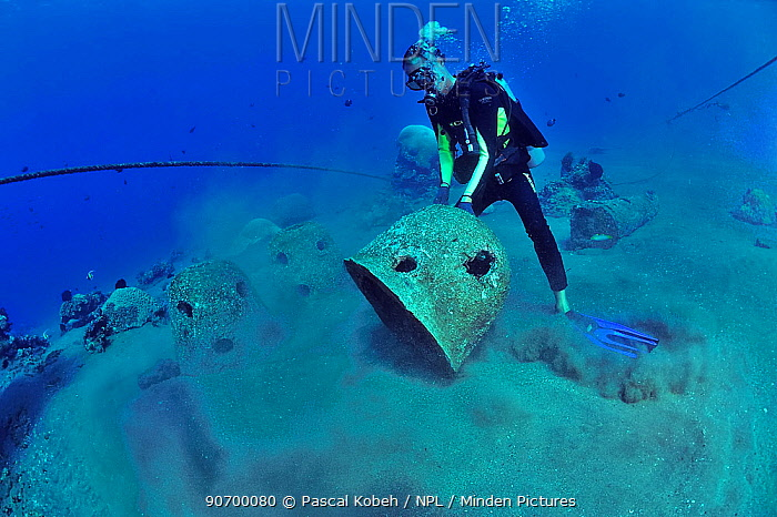 Divers are setting up concrete reef balls to build an artificial reef, Philippines, Sulu Sea. August 2014.