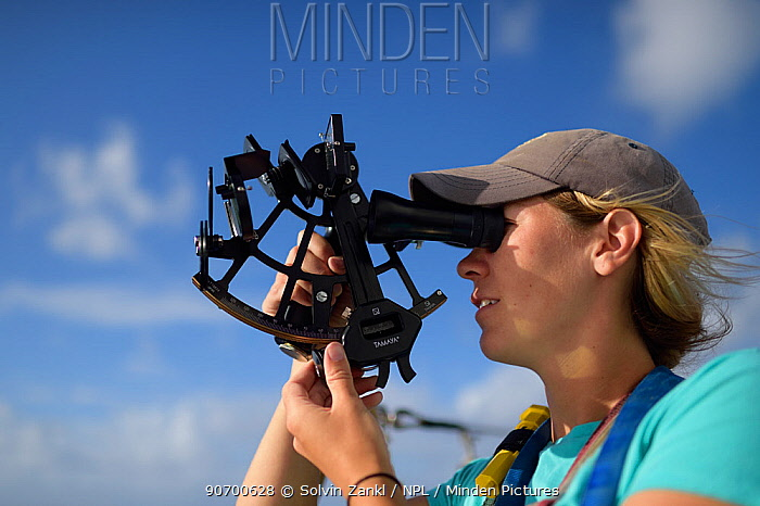Second mate of tall ship Corwith Crammer, a steel brigatine, using a sextant to navigate, Sargasso Sea, Bermuda.