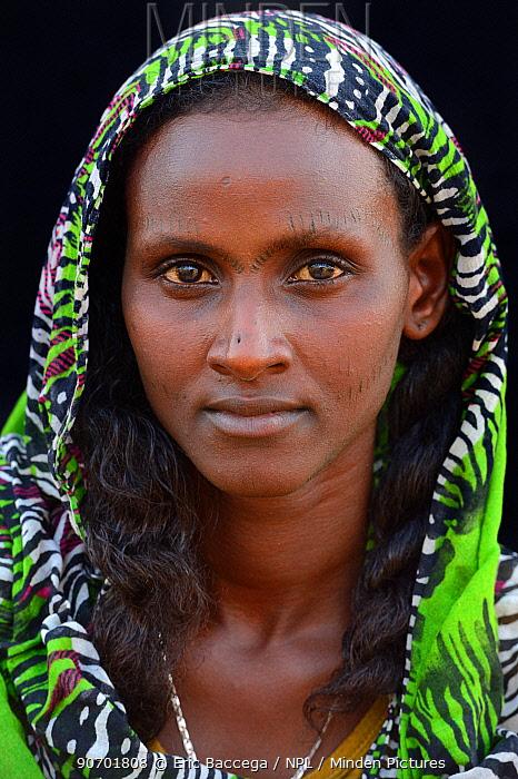 Head portrait of Afar tribe woman with facial tattoos / skin scarifications and wearing a scarf, Ahmed Ela village, Danakil depression, Afar region, Ethiopia, March 2015.