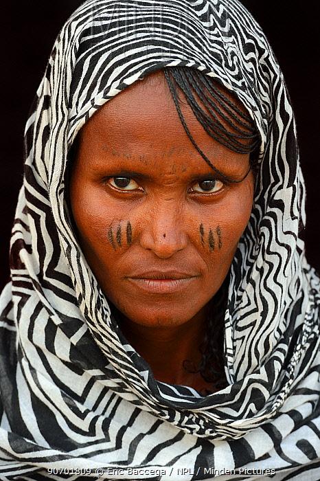 Head portrait of Afar tribe woman with facial tattoos / skin scarification and wearing a head scarf, Ahmed Ela village, Danakil depression, Afar region, Ethiopia, March 2015.