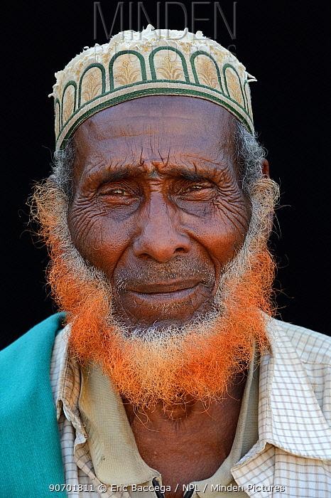 Head portrait of old Afar man, with beard dyed with henna, Ahmed Ela village, Danakil depression, Afar region.  Ethiopia, March 2015.