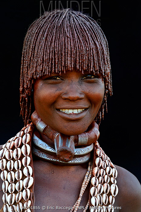 Young Hamer tribe woman with traditional necklaces and hair covered with a mixture of ochre and animal fat, Omo valley, Ethiopia, March 2015.
