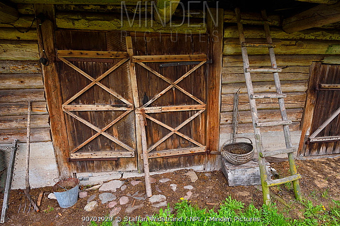 Wooden doorway to agricultural building in Musteika Village, Lithuania, May 2015.