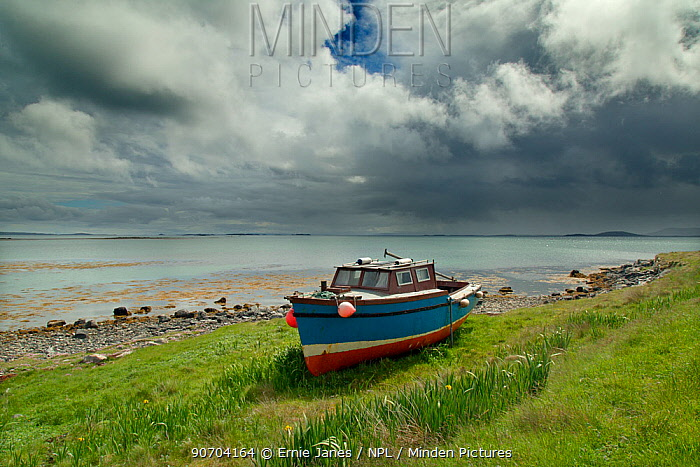 Old boat on shore of Bays Loch, Berneray, Hebrides, Scotland, UK, June.