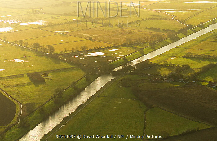 Aerial view of King's Sedgemoor Drain and agricultural land drying after winter floods, Somerset Levels, UK, February 2015.