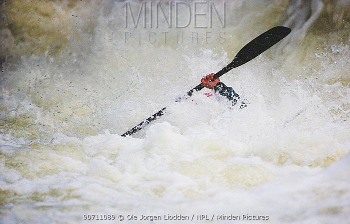 Man white water rafting, Valdres, Norway, June 2006.