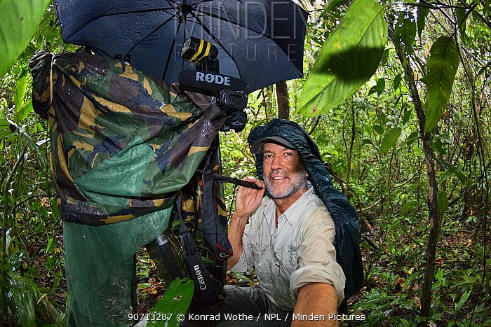German wildlife photographer Konrad Wothe at work in the peruvian rainforest, Panguana reserve, Amazonian Basin, Peru. October 2013.