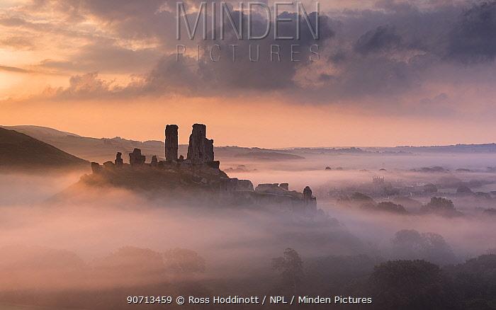 Corfe castle and village in morning mist, Corfe Castle, The Purbecks, Dorset, UK. September 2014.