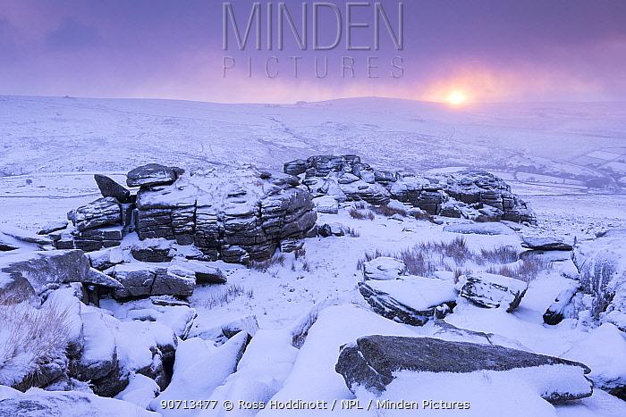 Great Staple Tor covered in snow, at sunrise, Dartmoor National Park, Devon, UK. January 2015.