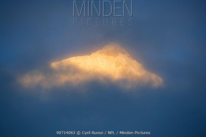 Summit of Huandoy mountain (6356m) lit up in the dawn light, Cordillera Blanca Massif, Peru.