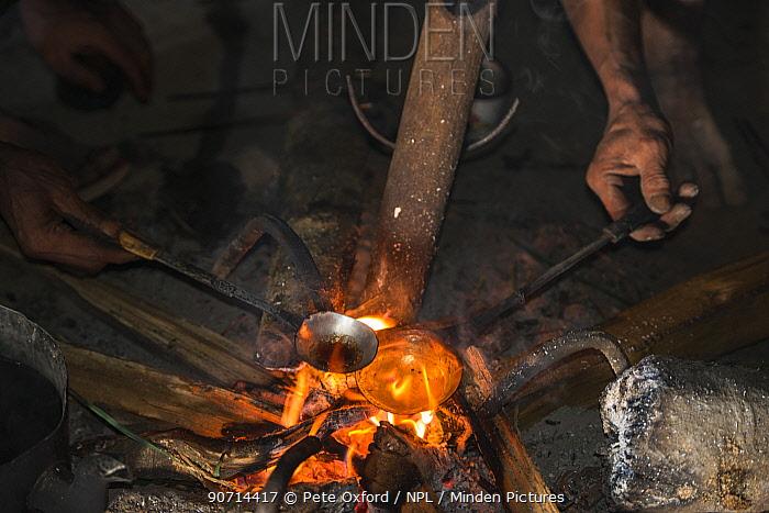 Konyak Naga man preparing opium to smoke. Mon district. Nagaland,  North East India, October 2014.