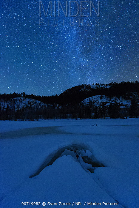 Frozen lake at night in under the Milky Way. Flatanger, Norway, January 2010.