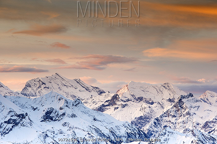Winter landscape with view towards the high Swiss Alps at sunset. Bernese Alps, Switzerland, November 2014