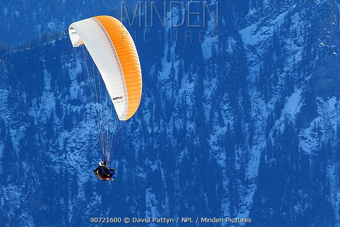 Paraglider in mountain landscape, Bernese Alps, Switzerland, November 2014.