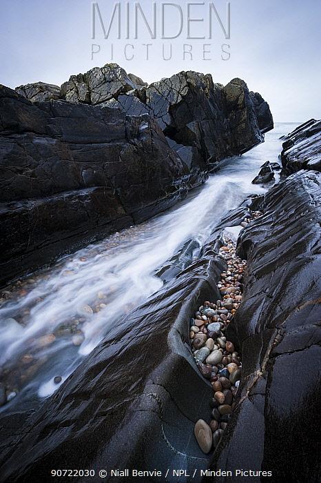 Long exposure of water rushing through inlet at, Saligo Bay, Islay, Inner Hebrides, February.