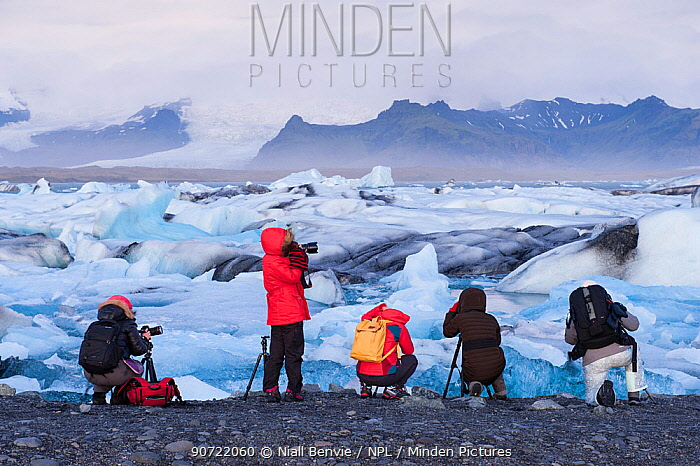 Photographers taking pictures of washed up ice volcanic beach at Jokulsarlon, Iceland, September 2015.