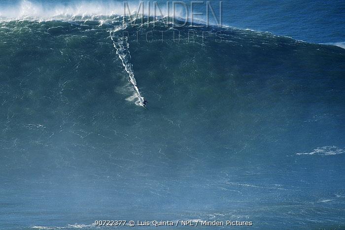 Surfer riding a big wave, Praia do Norte, Nazare, Portugal, December 2014.