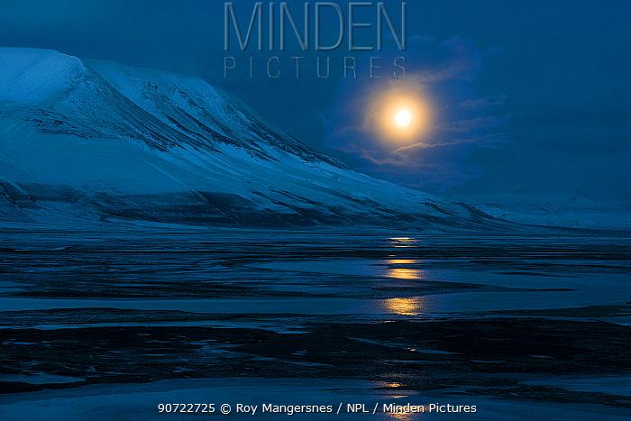 Full moon over Adventsdlen, Longyearbyen, Svalbard, Norway, April.