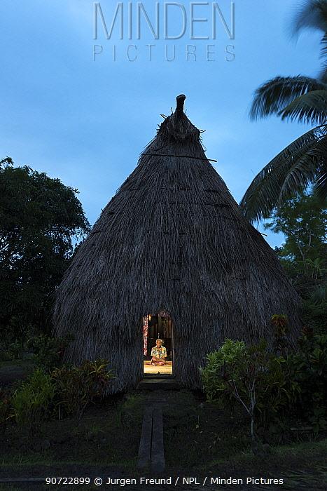Village Chief Ratu Jovilisi Nagatalevu inside hisl Fijian bure hut,traditionally made with forest wood and straw roof and walls, Mali Island, Macuata Province, Fiji, South Pacific.