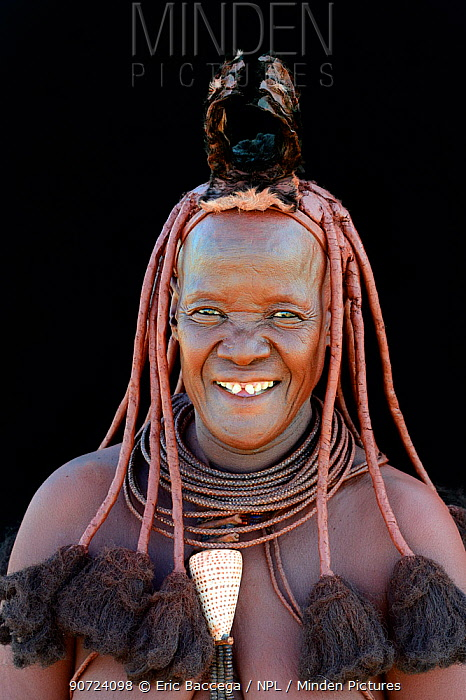 Portrait of Himba woman with traditional hair and jewellery, Kaokoland, Namibia October 2015