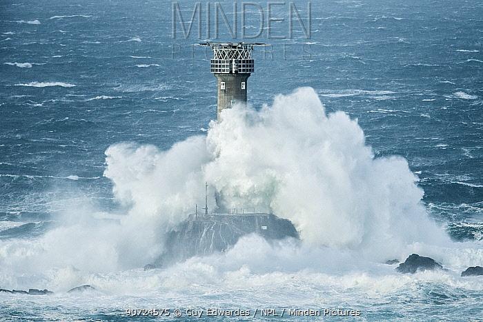 Big waves breaking over Longships Lighthouse, Land's End, Cornwall, England, UK. December 2014.