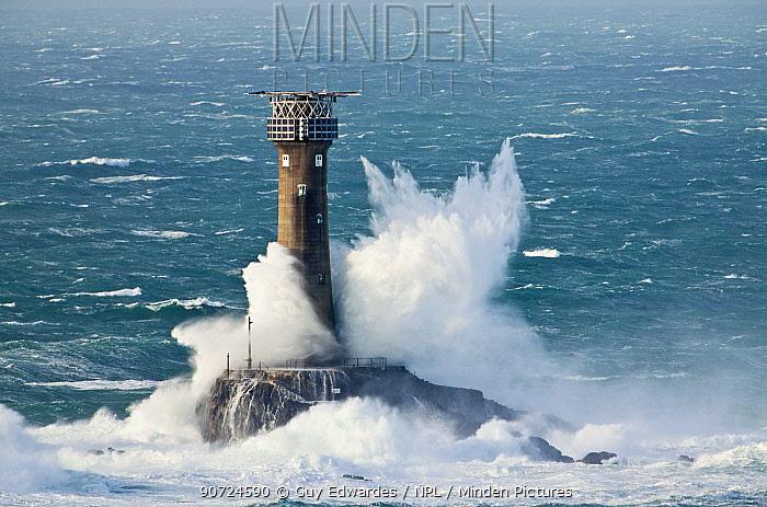 Big waves breaking over Longships Lighthouse, Land's End, Cornwall, England, UK. November 2009.