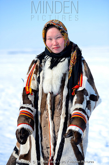 Carolina Serotetto, Nenet teenager in traditional winter coat made with reindeer skin. The collar is arctic fox fur and black beaver with felt ribbons. Yar-Sale district, Yamal, Northwest Siberia, Russia. April 2016.