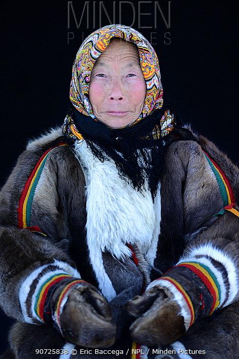 Tatiana Salinder, portrait of Nenet herder in winter coat of reindeer fur. The collar is arctic fox fur with black beaver fur and felt ribbons. Yar-Sale district, Yamal, Northwest Siberia, Russia. April 2016.