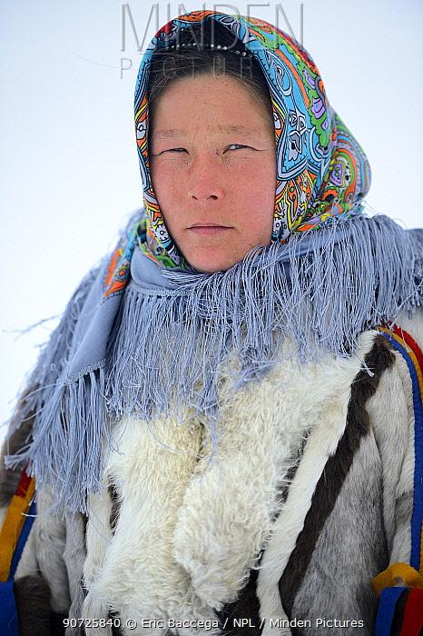 Ekaterina Yaptik, portrait of Nenet herder in winter coat made of reindeer fur. The collar is arctic fox fur with black beaver straps and felt ribbons. Yar-Sale district, Yamal, Northwest Siberia, Russia. April 2016.