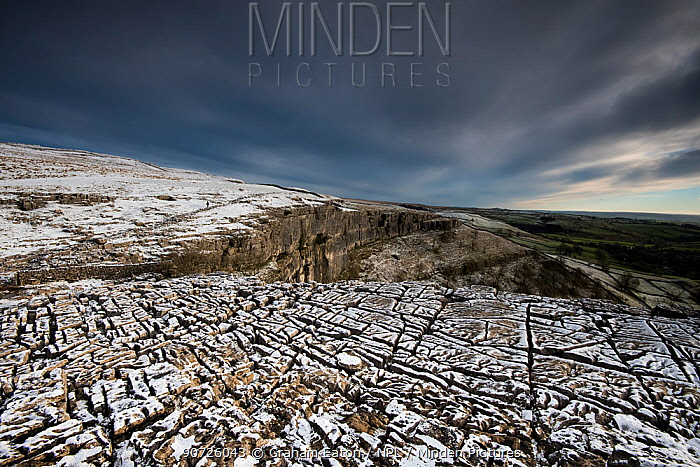 Carboniferous Limestone pavement above Malham Cove, with light dusting of snow, Yorkshire, UK.  January 2014