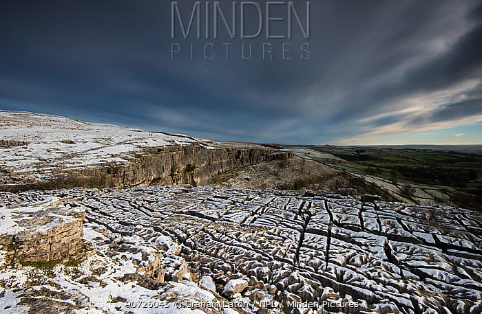 Carboniferous Limestone pavement above Malham Cove, with light dusting of snow,Yorkshire, UK.  January 2014