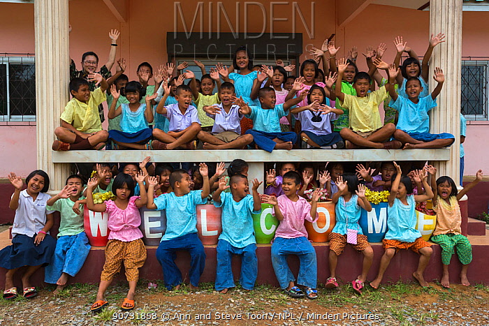 Pang Sida national park community outreach volunteer Radabha 'Huang' Prapapornpipat (left, back row) with children at Baan Klong Pla Do school, eastern Thailand, August, 2014.