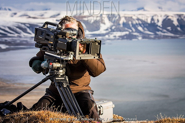 Cameraman filming, Svalbard, Norway, June. Taken on location for BBC 'Life' series.