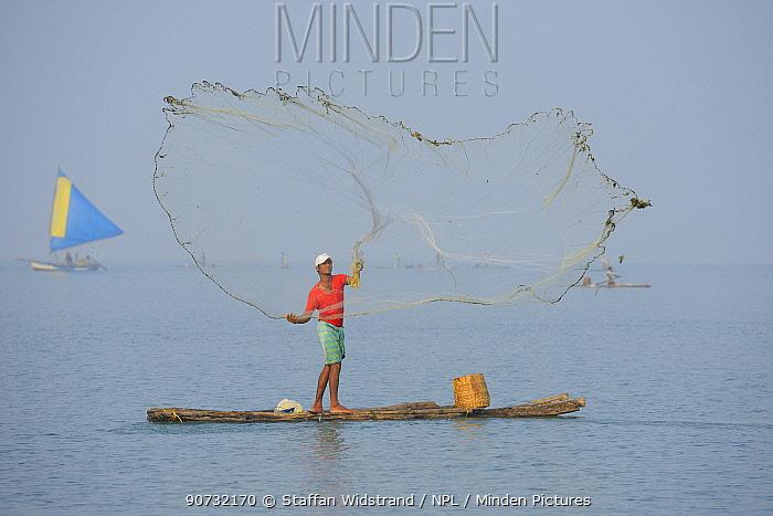 Throw-net fisherman, on raft, Pulicat Lake, Tamil Nadu, India, January 2013.