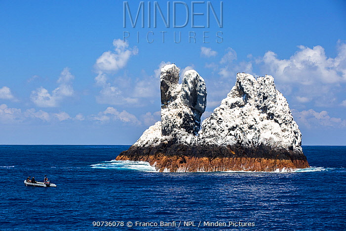 Roca Partida,  a small rock island covered in white bird guano  in the Revillagigedo Archipelago Biosphere Reserve, Socorro Islands, Western Mexico