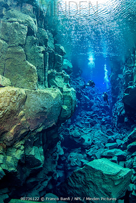 Scuba divers at Davosgja, a fissure located in Lake Thingvellir, not as famous as Silfra but a favourite with local divers, Thingvellir National Park, Iceland.