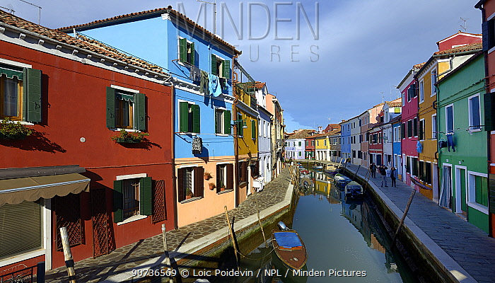 View down a canal in Burano, one of the islands in the lagoon, Venice, Italy 2016