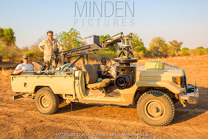 Producer Huw Cordey, and wildlife cameraman Jamie McPherson, on filming vehicle - with 4K gyro stabilised cineflex suspended from a jib arm. On Location to film BBC series 'The Hunt' South Luangwa National Park, Zambia. Novemeber 2014.