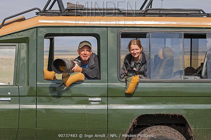 Wildlife Photographer Ingo Arndt and his wife, videographer Silke Arndt, working together in Masai Mara Game Reserve, Kenya