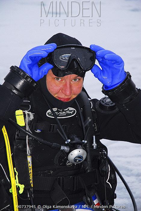 Portrait of photographer Olga Kamenskaya in diving gear, Lake Baikal, Russia, February 2008.