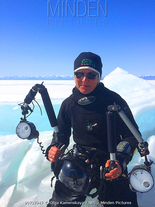 Portrait of photographer Olga Kamenskaya in diving gear, Lake Baikal, Russia, August 2014.
