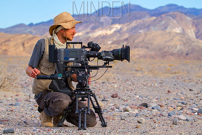 German wildlife cameraman, Rolf Steinmann, gets ready to film on his Arri Alexa, Death Valley, California. May 2011 on location for Discovery North America series