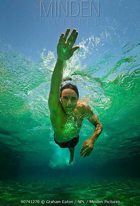 A boy swimming crawl stroke in a pool, Egypt, September 2012. Model released